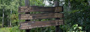 Pine Line Trail Mileage sign, Trail Head in Medford, Wis. Medford Inn, Affordable hotel.